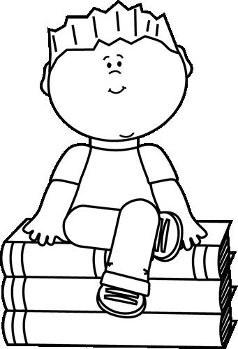 Black and White Kid Sitting on Books