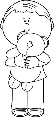 Black and White Boy Holding a Teddy Bear
