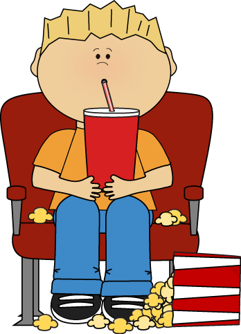 Boy in Movie Theater with Drink and Popcorn with Drink and Popcorn