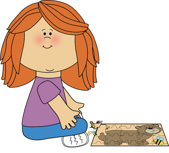 Girl Putting a Puzzle Together