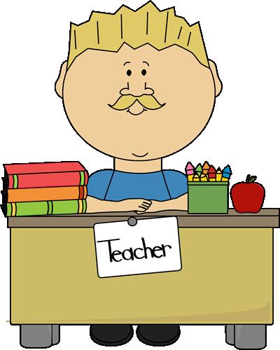 Blond Male Teacher Sitting at a Desk